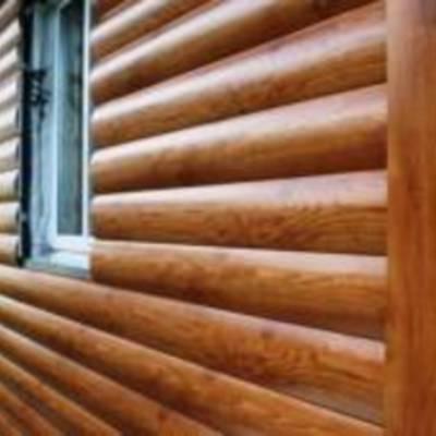 Металлический сайдинг под деревянный брус